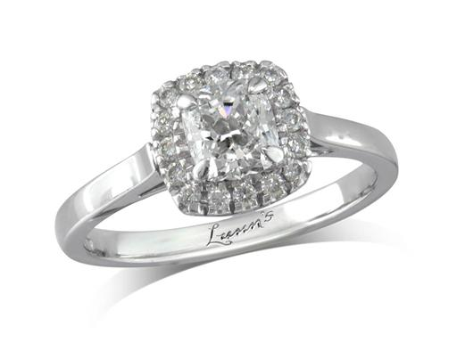 Platinum set diamond engagement ring, with a certificated cushion cut centre in a four claw setting, surrounded by a diamond set cluster. Total diamond weight: 0.86ct.