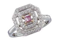 Platinum set cluster ring, with a certificated Natural Fancy Vivid Purplish Pink centre diamond in a four claw setting, with a surrounding diamond set bezel. Total cluster diamond weight: 0.62ct.