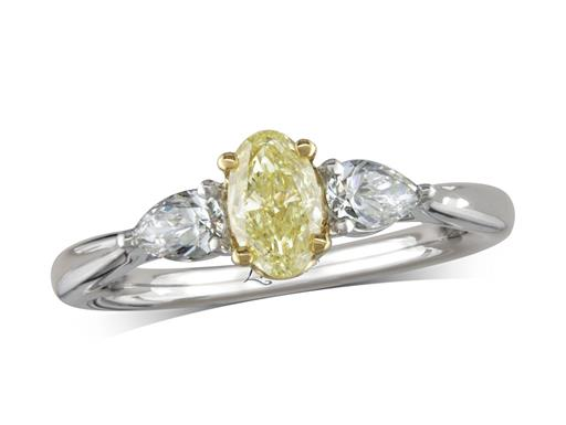 Platinum three stone diamond engagement ring, with a certificated oval cut Natural Fancy Yellow centre diamond in a four claw yellow gold setting, and one pear cut on each shoulder. Perfect fit with a wedding ring. Total diamond weight: 0.87ct