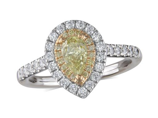 Platinum diamond cluster engagement ring, with a certificated pear cut Natural Fancy Yellow Diamond centre in a three claw setting, with a surrounding 18ct yellow gold bezel set with yellow diamonds and an outer row of diamonds and diamond set shoulders. Total cluster diamond weight: 0.92ct.