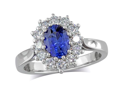 Platinum set cluster ring, with an exceptional blue oval sapphire centre in a claw setting, with twelve diamonds surrounding. Total cluster diamond weight: 0.51ct.