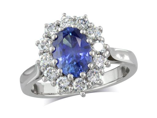 Platinum set cluster ring, with an exceptional blue oval sapphire centre in a claw setting, with twelve diamonds surrounding. Total cluster diamond weight: 0.63ct.