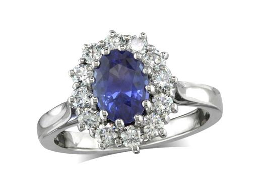 Platinum set cluster ring, with an exceptional blue oval sapphire centre in a claw setting, with a surrounding diamond set bezel. Total cluster diamond weight: 0.62ct.