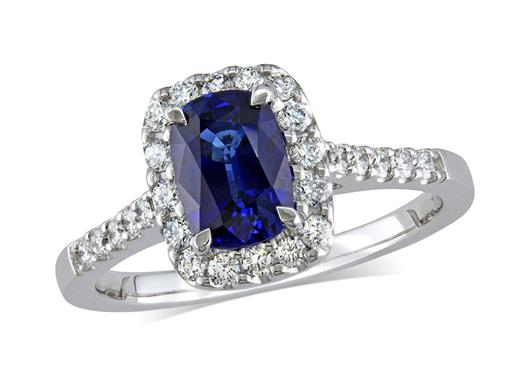 Platinum set cluster ring, with an exceptional blue cushion cut sapphire centre in a claw setting, with a surrounding diamond set bezel and diamond shoulders. Total cluster diamond weight: 0.37ct.