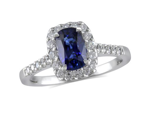 Platinum cluster ring, with a cushion cut sapphire centre in a claw setting, with a surrounding diamond set bezel and diamond shoulders. Total cluster diamond weight: 0.37ct.