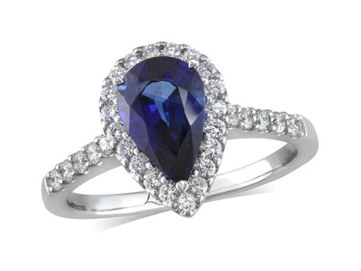 Platinum set cluster ring, with an exceptional blue pear cut sapphire centre in a claw setting, with a surrounding diamond set bezel and diamond shoulders. Total cluster diamond weight: 0.36ct.