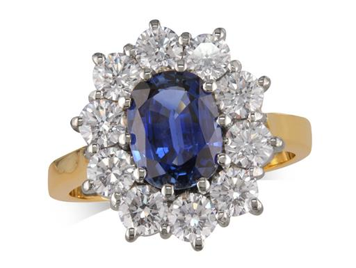 18 carat yellow gold cluster ring, with an oval cut sapphire centre weighing 2.03ct, surrounded by 10 brilliant cut diamonds. Total cluster diamond weight: 1.75ct.