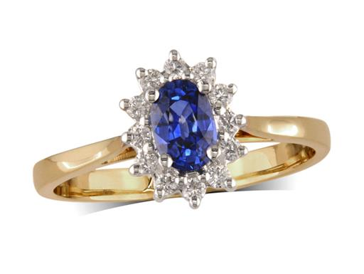 18 carat yellow gold cluster ring, with an oval cut sapphire centre weighing 0.60ct, surrounded by 12 brilliant cut diamonds. Total cluster diamond weight: 0.17ct.