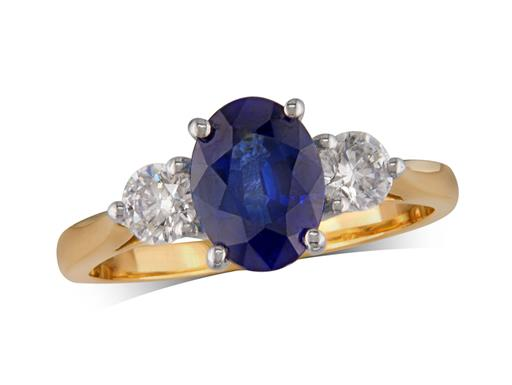 18 carat yellow gold three stone ring, with an oval cut sapphire centre weighing 1.62ct, and one brilliant cut diamond on each shoulder. Total diamond weight: 0.44ct.