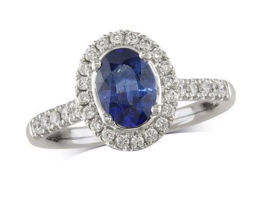 Platinum ring, with an oval cut sapphire centre weighing 0.94ct, with a surrounding diamond set bezel and diamond set shoulders. Total diamond weight is 0.35ct.