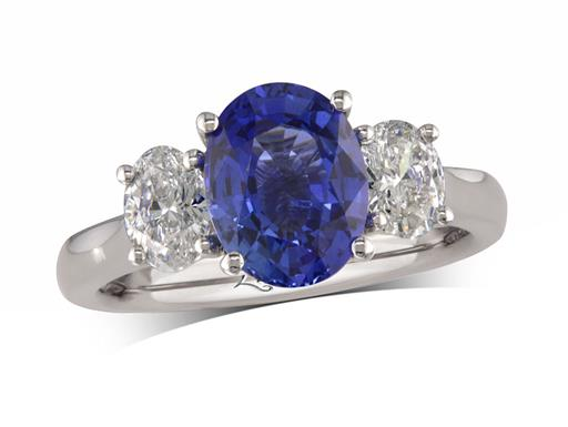 Platinum ring, with an oval cut sapphire centre weighing 2.38ct in a four claw setting, and one oval cut diamond on each shoulder. Total diamond weight: 0.68ct.