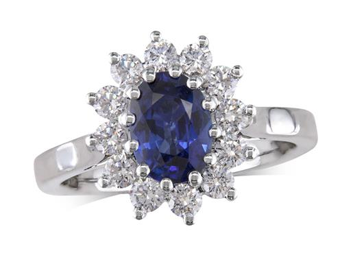 Platinum cluster ring, with an oval sapphire centre in a claw setting, with twelve diamonds surrounding. Total cluster diamond weight: 0.60ct.