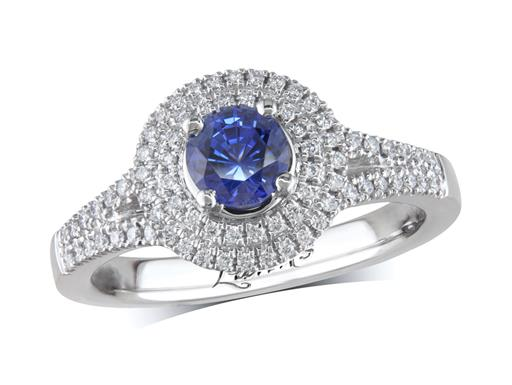 Platinum ring, with a brillliant cut sapphire centre weighing 0.67ct, surrounded by a double row bezel of brilliant cut diamonds and diamond set split shoulders. Total diamond weight is 0.29ct.