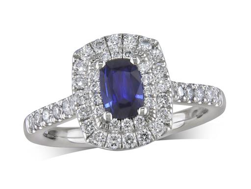 Platinum ring, with a cushion cut sapphire centre weighing 0.44ct, with a surrounding double row diamond set bezel and diamond set shoulders. Total diamond weight is 0.51ct.