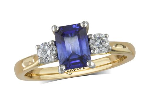 18 carat yellow gold three stone ring, with an emerald cut sapphire centre weighing 1.22ct, and one brilliant cut diamond on each shoulder. Total diamond weight: 0.26ct.