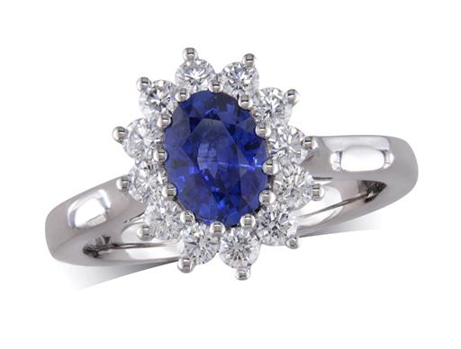 Platinum cluster ring, with an oval sapphire centre in a claw setting, with a surrounding diamond set bezel. Total cluster diamond weight: 0.50ct.