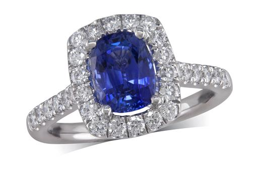 Platinum cluster ring, with a cushion cut sapphire centre weighing 1.82ct, with a surrounding diamond set bezel and diamond set shoulders. Total diamond weight is 0.61ct.