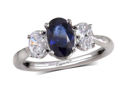 Platinum three stone ring, with an oval cut sapphire centre weighing 1.50ct, and one IGI certificated brilliant cut diamond on either side. Total diamond weight: 0.62ct, E colour, VS2 clairty.