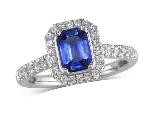 Platinum ring, with an emerald cut sapphire centre weighing 0.93ct, with a surrounding diamond set bezel and diamond set shoulders. Total diamond weight is 0.41ct.