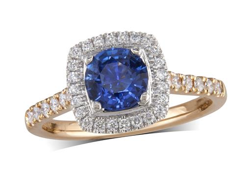 18 carat yellow gold ring, with a brilliant cut sapphire centre weighing 0.87ct, in a claw setting with a surrounding diamond set bezel housed in platinum, and diamond set shoulders. Total diamond weight is 0.28ct.