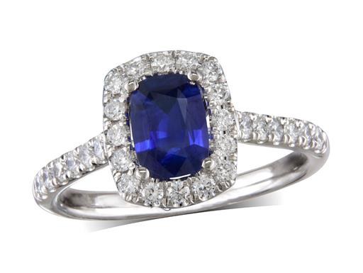 Platinum ring, with a cushion cut sapphire centre weighing 0.78ct, with a surrounding diamond set bezel and diamond set shoulders. Total diamond weight is 0.46ct.