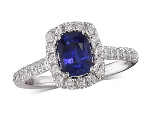 Platinum ring, with a cushion cut sapphire centre weighing 0.95ct, with a surrounding diamond set bezel and diamond set shoulders. Total diamond weight is 0.46ct.