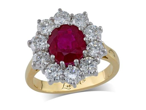 18 carat yellow gold cluster ring, with an oval cut ruby centre weighing 1.82ct, with 10 diamonds surrounding. Total diamond weight: 1.65ct.