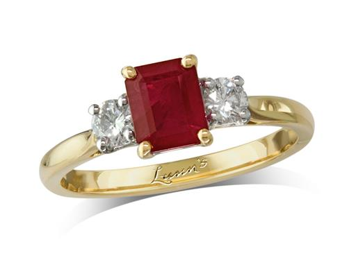 18 carat yellow gold three stone ring, with an octagonal cut ruby centre weighing 1.13ct, and one brilliant cut diamond on each shoulder. Total diamond weight: 0.29ct.