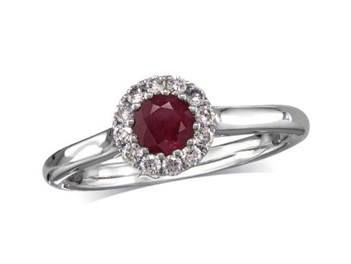 Platinum cluster ring, with a round cut ruby centre weighing 0.43ct, in a claw setting, with twelve diamonds surrounding. Total cluster diamond weight: 0.17ct.