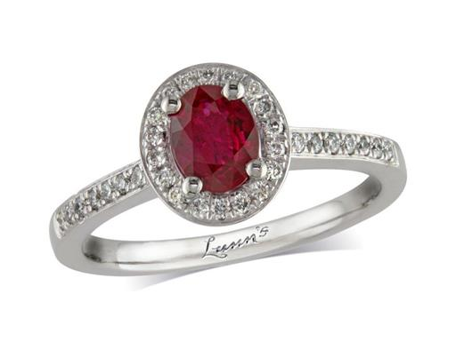 Platinum ring, with an oval cut ruby centre weighing 0.61ct, with a surrounding diamond set bezel and diamond set shoulders. Total diamond weight is 0.17ct.