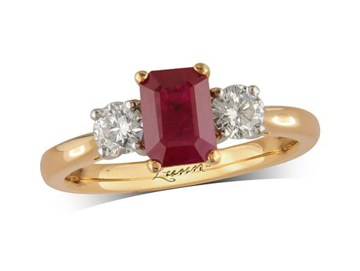 18 carat yellow gold three stone ring, with an octagonal cut ruby centre weighing 1.14ct, and one brilliant cut diamond on each shoulder. Total diamond weight: 0.41ct.