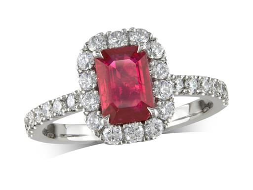 Platinum cluster ring, with an octagonal cut ruby centre weighing 1.00ct, with a surrounding diamond set bezel and diamond set shoulders. Total cluster diamond weight is 0.63ct.