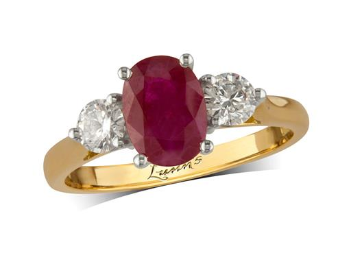 18 carat yellow gold three stone ring, with an oval cut ruby centre weighing 1.32ct, and one brilliant cut diamond on each shoulder. Total diamond weight: 0.43ct.