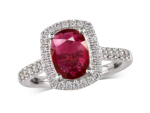 Platinum ring, with a cushion cut ruby centre weighing 1.03ct, with a surrounding diamond set bezel and diamond set shoulders. Total diamond weight is 0.44ct.