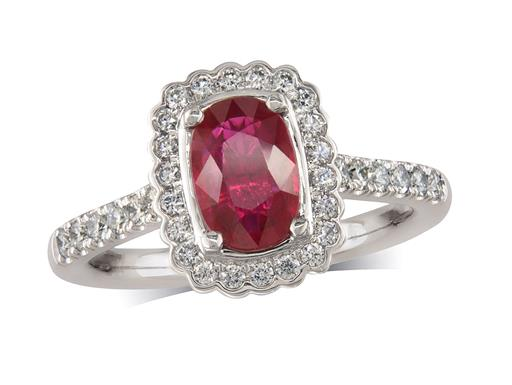 Platinum ring, with a cushion cut ruby centre weighing 1.03ct, with a surrounding diamond set bezel and diamond set shoulders. Total diamond weight is 0.41ct.