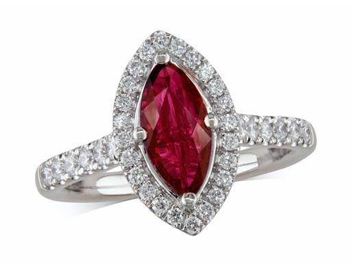 Platinum ring, with a marquise cut ruby centre weighing 1.10ct, with a surrounding diamond set bezel and diamond set shoulders. Total diamond weight is 0.43ct.