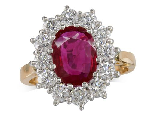 18 carat yellow gold cluster ring, with an oval cut ruby centre weighing 2.07ct, with 12 diamonds surrounding. Total diamond weight: 1.49ct.