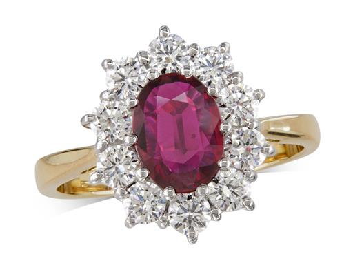 18 carat yellow gold cluster ring, with an oval cut ruby centre weighing 1.16ct, with 10 diamonds surrounding. Total diamond weight: 0.85ct.