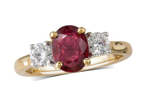 18 carat yellow gold three stone ring, with an oval cut ruby centre weighing 1.36ct, and a brilliant cut diamond on each shoulder. Total diamond weight: 0.49ct.