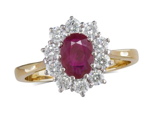 18 carat yellow gold cluster ring, with an oval cut ruby centre weighing 1.07ct, with 10 diamonds surrounding. Total diamond weight: 0.62ct.