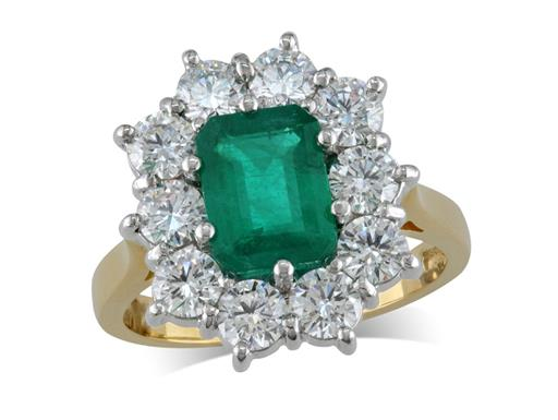 18 carat yellow gold cluster ring, with an emerald cut emerald centre weighing 1.38ct, with 10 diamonds surrounding. Total cluster diamond weight: 1.72ct.