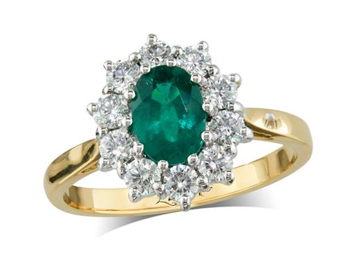 18 carat yellow gold cluster ring, with an oval cut emerald centre weighing 0.59ct, surrounded by 10 brilliant cut diamonds. Total diamond weight: 0.43ct.