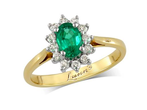 18 carat yellow gold cluster ring, with an oval cut emerald centre weighing 0.38ct, surrounded by 12 brilliant cut diamonds. Total diamond weight: 0.17ct.