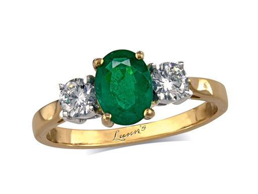 18 carat yellow gold ring with an oval cut emerald centre weighing 1.17ct in a four claw setting, and one brilliant cut diamond on each shoulder. Total diamond weight: 0.38ct.