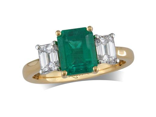 18 carat yellow gold three stone ring, with an emerald centre weighing 1.73ct, and one emerald cut diamond on each shoulder. Total diamond weight: 0.83ct.