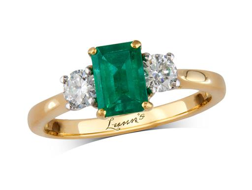 18 carat yellow gold three stone ring, with an emerald centre weighing 0.80ct, and one brilliant cut diamond on each shoulder. Total diamond weight: 0.39ct.