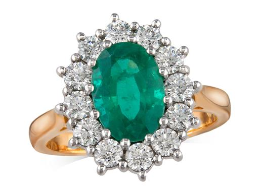 18 carat yellow gold cluster ring, with an oval cut emerald centre weighing 1.84ct, with 12 diamonds surrounding. Total cluster diamond weight: 1.01ct.