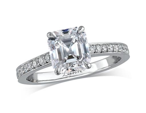 Platinum set single stone diamond engagement ring, with a certificated emerald cut centre in a four claw setting, and diamond set shoulders. Total diamond weight: 2.28ct.