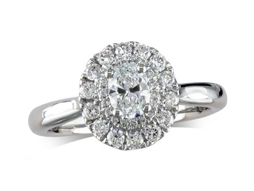 Platinum diamond cluster engagement ring, with a certificated oval cut centre in a four claw setting, with a surrounding double diamond set bezel. Total cluster diamond weight: 0.72ct.
