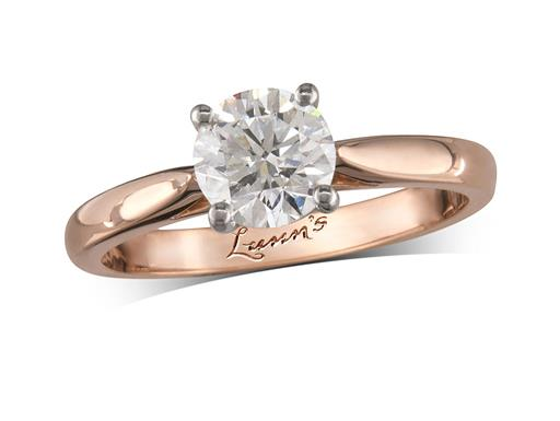 18 carat rose gold single stone diamond engagement ring, with a certificated brilliant cut, in a four claw setting.